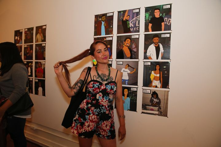 <em>Crystal Marich posses next to her portrait.</em>