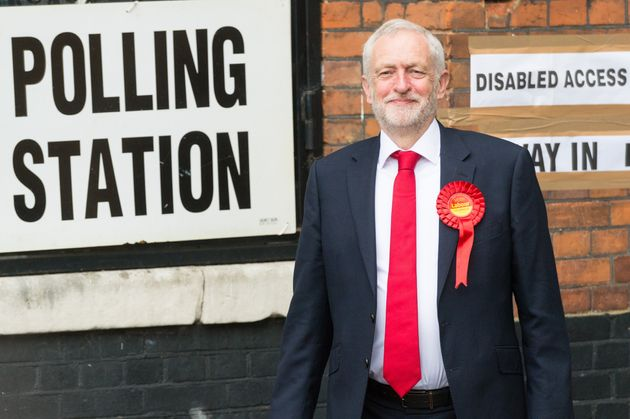 British Labour Party Leader Jeremy Corbyn leaves Pakeman Primary School polling station after casting...