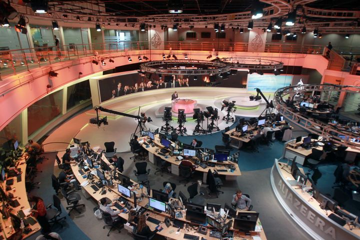 Staff work inside the headquarters of Al Jazeera Network, in Doha, Qatar, on Thursday.