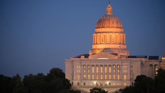 The lights come up as the sun fades on the capital building downtown Jefferson City, Missouri