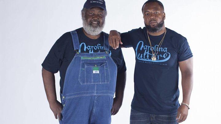 <i>Ed Mitchell (left) with son Ryan.</i>