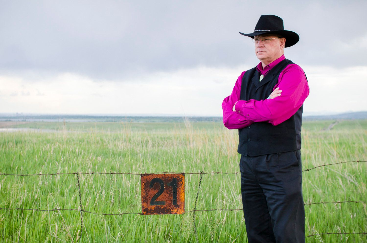Jon Lipsky the retired FBI agent who led the raid on Rocky Flats June 6 1989 stands along the fence at the refuges northern border