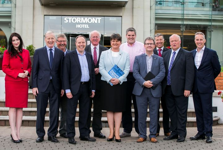 DUP leaders Arlene Foster, center, stands with newly elected Members of Parliament in Belfast, Northern Ireland, on Frid