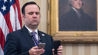 WASHINGTON, DC - MARCH 31: White House aide Dan Scavino listens and films as President Donald Trump speaks during an executive order signing ceremony regarding trade in the Oval Office of the White House in Washington, DC on Friday, March. 31, 2017. (Photo by Jabin Botsford/The Washington Post via Getty Images)