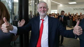 Britain's opposition Labour party Leader Jeremy Corbyn gives a thumbs up as he arrives at Labour Party headquarters in central London on June 9, 2017 after results in a snap general election showing a hung parliament with Labour gains and the Conservatives losing its majority. British Prime Minister Theresa May faced pressure to resign on Friday after losing her parliamentary majority, plunging the country into uncertainty as Brexit talks loom. The pound fell sharply amid fears the Conservative leader will be unable to form a government and could even be forced out of office after a troubled campaign overshadowed by two terror attacks. / AFP PHOTO / Daniel LEAL-OLIVAS        (Photo credit should read DANIEL LEAL-OLIVAS/AFP/Getty Images)
