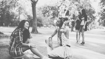Group of teenage girls talking and laughing outside