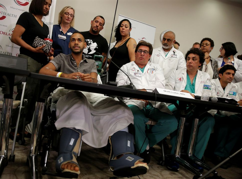 Gunshot survivor Angel Colon speaks at a news conference at the Orlando Regional Medical Center on the shooting at the Pulse