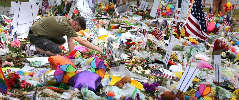 A visitor to the makeshift memorial for the victims of the Pulse massacre relights a candle after an...