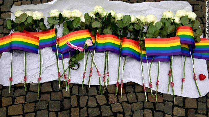 49 white roses and rainbow flags for the lives lost in the Orlando Pulse attack.