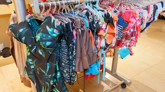 Display of womens swimwear clothing hanging in clothes shop