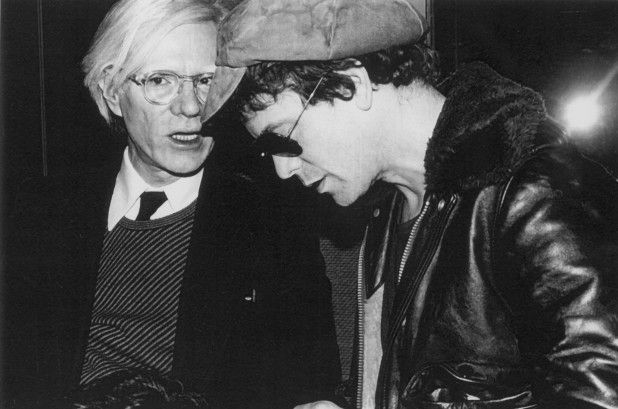 Andy Warhol conferring with Lou Reed.