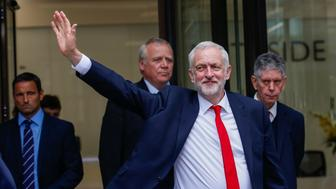 Jeremy Corbyn, leader of the U.K. opposition Labour Party, gestures as he leaves the party's headquarters in London, U.K., on Friday, June 9, 2017. Theresa May'sfuture as Britain's prime minister was thrown into doubt after her gamble to call an early election backfired spectacularly just 10 days before Brexit negotiations are due to start. Photographer: Luke MacGregor/Bloomberg via Getty Images