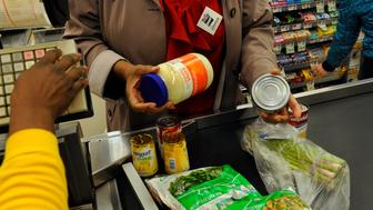 ROCKVILLE, MD - FEB 04: Judith Clark from Women Who Care Ministries had to put several items back, including a jar of mayonnaise as she was well over her $25.00 limit for the day at first tally. Her final tally was $24.61 for the shopping spree. Members of the Montgomery County Council as well as local activists and members the the Montgomery County Board of Education took part in a shopping venture to see if they could live on $5.00 a day worth of food. They had a $25.00 limit (5-day supply) as part of the SNAP (Supplemental Nutrition Assistance Program, the new name for food stamps). It was an effort to raise poverty awareness in an otherwise affluent county. Photo by Michael S. Williamson/The Washington Post via Getty Images