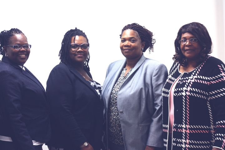 Pearlie Mae Smith (far right) and her children won the Powerball jackpot.
