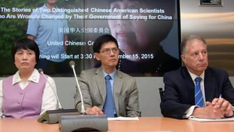 WASHINGTON D.C., Sept. 16, 2015--Chinese-American scientist Dr. Xiaoxing Xi, center, and Chinese-American hydrologist Sherry Chen, left, attend a press conference at Arent Fox in Washington D.C., capital of the United States, Sept. 15, 2015. U.S. lawmakers and Asian American advocacy groups on Tuesday urged the country's Department of Justice and the Federal Bureau of Investigation to investigate what appeared to be a 'growing pattern' of accusing innocent Chinese-Americans of spying for China. The move came days after the Department of Justice dropped all charges against Professor Xi Xiaoxing of Temple University, who was accused of sharing sensitive U.S. technology with China, and a similar case against National Weather Service hydrologist Sherry Chen, which was dropped in March. (Xinhua/Bao Dandan via Getty Images)