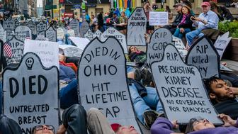 33 STREET PLAZA, NEW YORK, UNITED STATES - 2017/06/04: Health providers, patients, grassroots organizers and concerned New York residents organized a Die-In against Trumpcare and for affordable coverage for all on June 4, 2017; at 33 Street Plaza, W. 33 St. between 7th and 8th Aves, Manhattan. Protesters rally to warn US Senate of human toll of repeal/replace health plans. (Photo by Erik McGregor/Pacific Press/LightRocket via Getty Images)