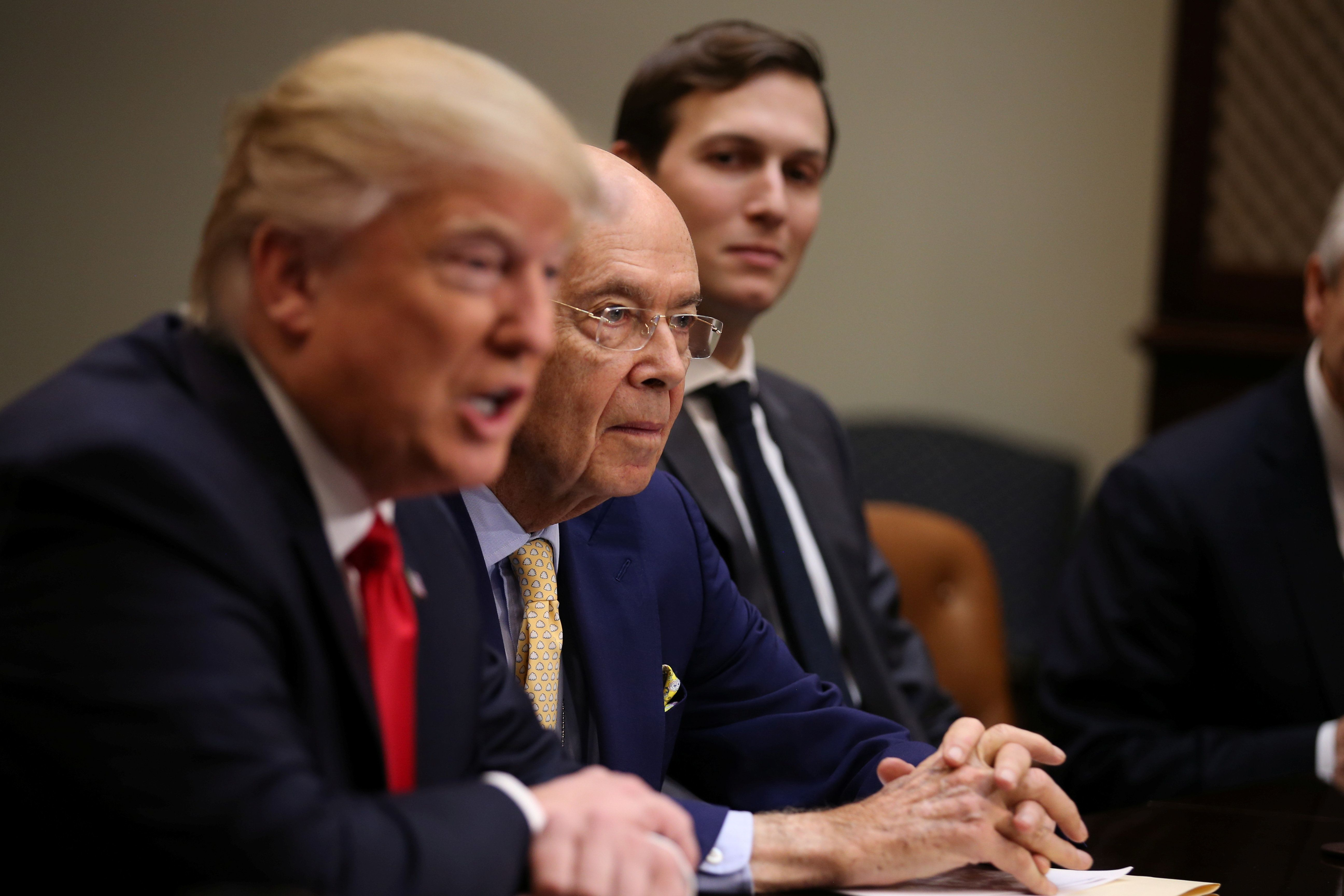 Wilbur Ross, Trump's pick for Commerce Secretary (C), U.S. President Donald Trump and Senior advisor and Trump's son-in-law Jared Kushner (R) attend a meeting with congressional leaders to discuss trade deals at the at the Roosevelt room of the White House in Washington U.S., February 2, 2017. REUTERS/Carlos Barria