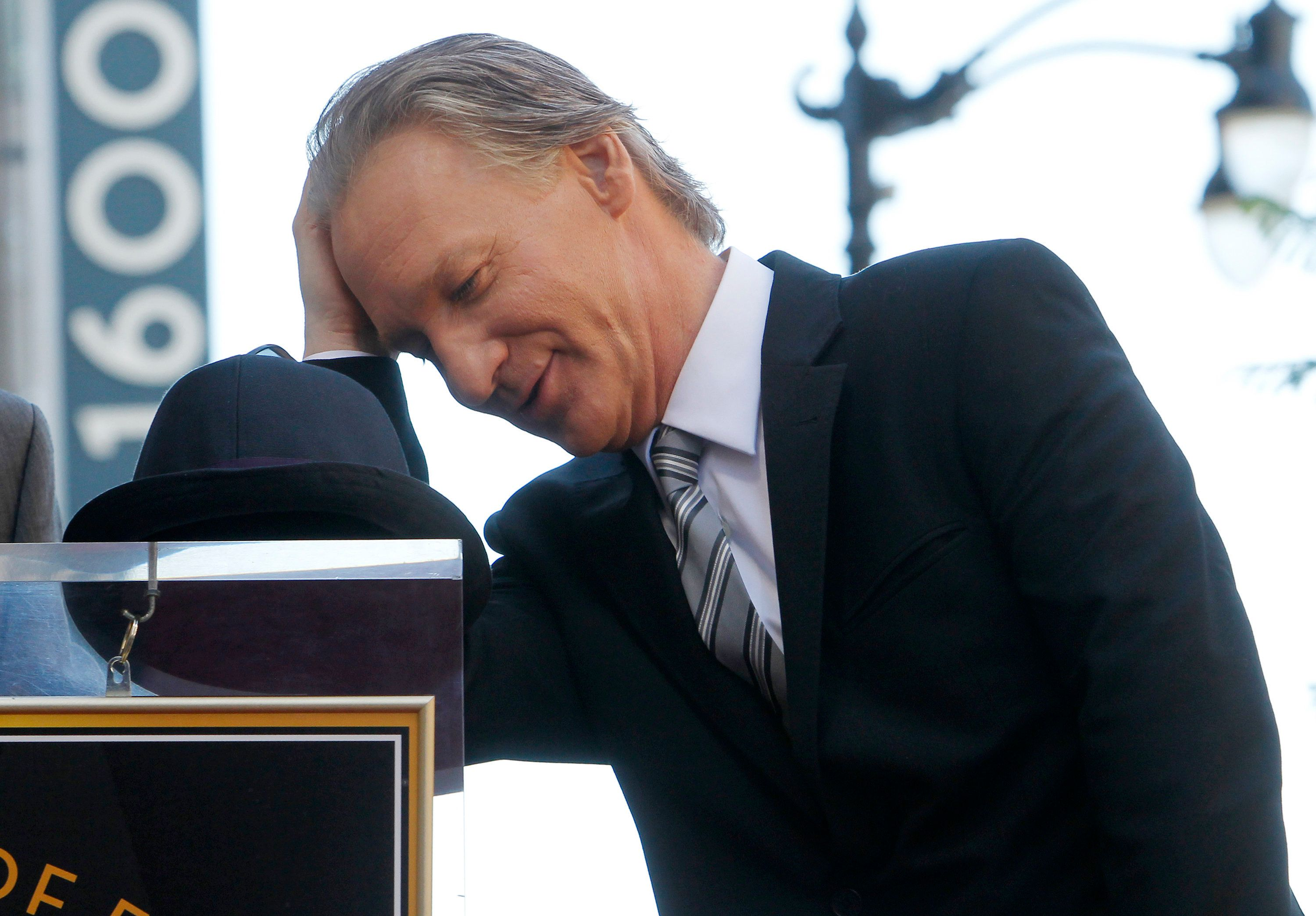 Comedian Bill Maher reacts as he waits for Hollywood Chamber of Commerce president and CEO Leron Gubler to finish his introduction of King at ceremonies unveiling Maher's star on the Hollywood Walk of Fame in Hollywood September 14, 2010.  REUTERS/Fred Prouser   (UNITED STATES - Tags: ENTERTAINMENT)