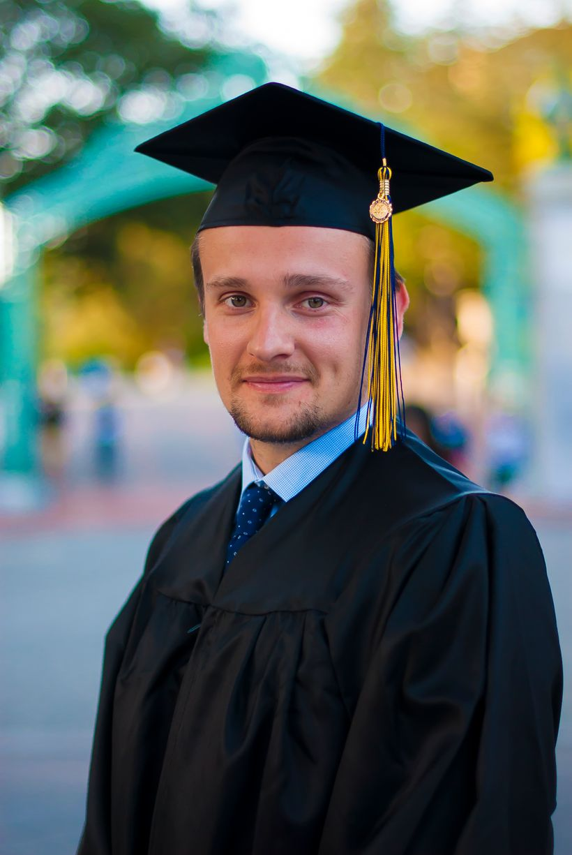 Kirill is pictured here in his graduation gap in front of the iconic Sather Gate on the UC Berkeley campus, the university he