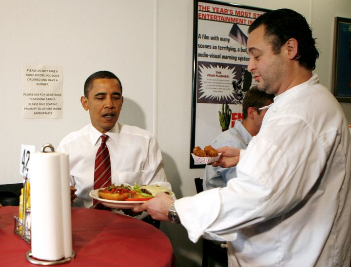 "Former President Barack Obama receives his ""fancy"" lunch order at Ray's Hell Burger in Arlington, Virginia, in May 2009.&nbsp"