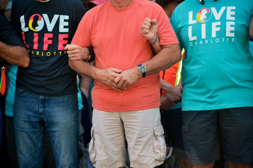 Members of Love Life Charlotte pray together outside of the abortion