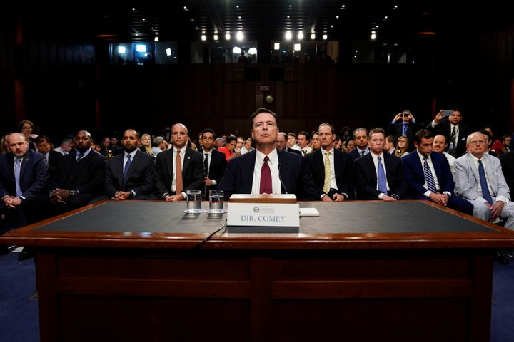Former FBI Director James Comey testifies before a Senate Intelligence Committee hearing on Russia's alleged interference in