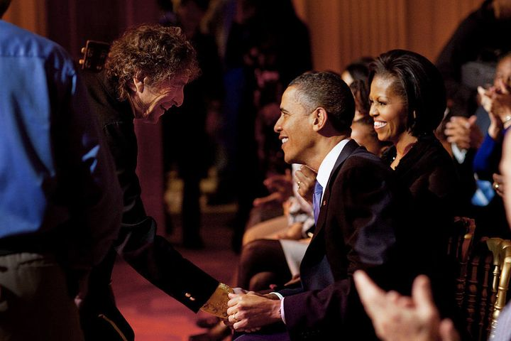 "Genuine and mutual admiration: Bob Dylan shakes President Barack Obama's hand following his performance at the ""In Performanc"