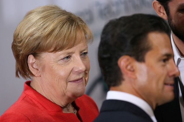 German Chancellor Angela Merkel and Mexico President Enrique Pena Nieto participate in an event with...