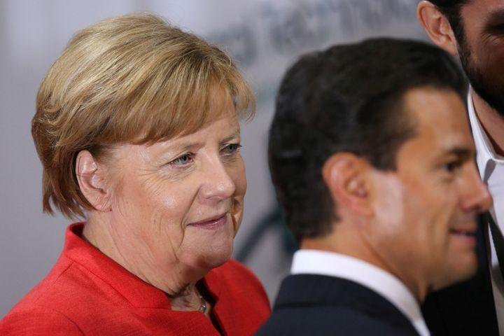 German Chancellor Angela Merkel and Mexico President Enrique Pena Nieto participate in an event with Mexican and German busin