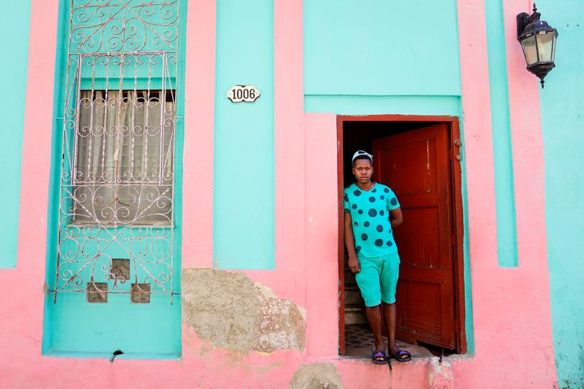 I saw this boy exit this doorway and couldn't believe the color synchronicity so I asked him to pose for me.