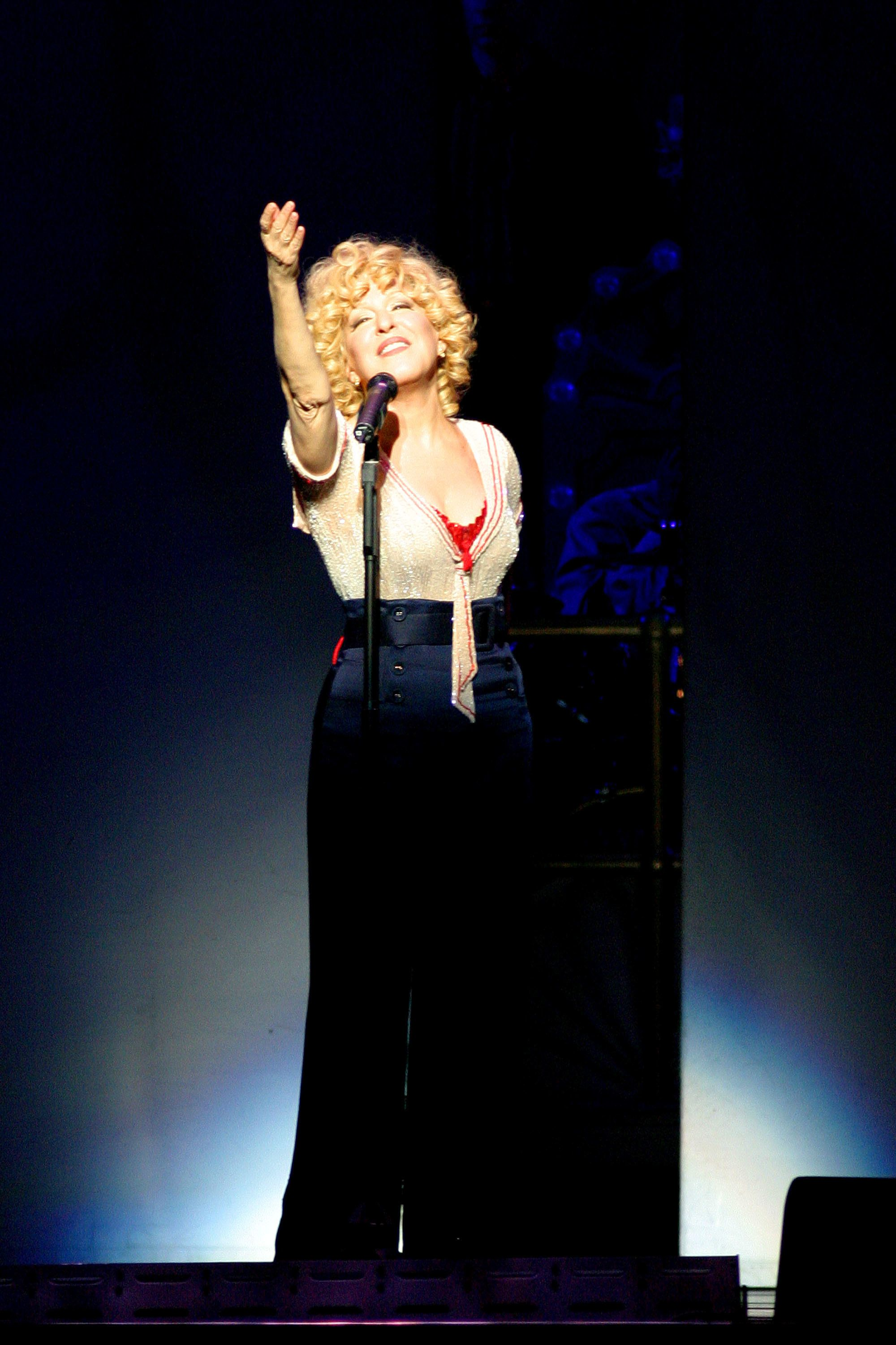 ATLANTIC CITY, NJ - OCTOBER 9:  Bette Midler performs during her 'Kiss My Brass' tour at the Atlantic City Boardwalk Hall October 9, 2004 in Atlantic City, New Jersey.  (Photo by Donald B. Kravitz/Getty Images)