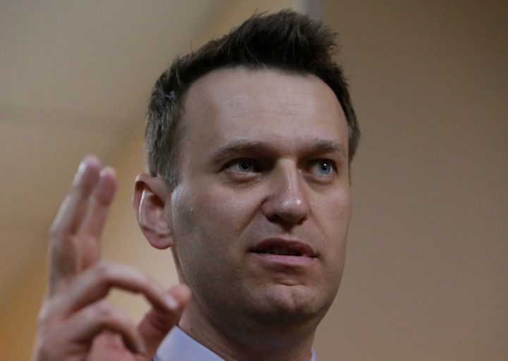 Russian leading opposition figure Alexei Navalny gestures during a break in a hearing in the slander lawsuit filed against hi