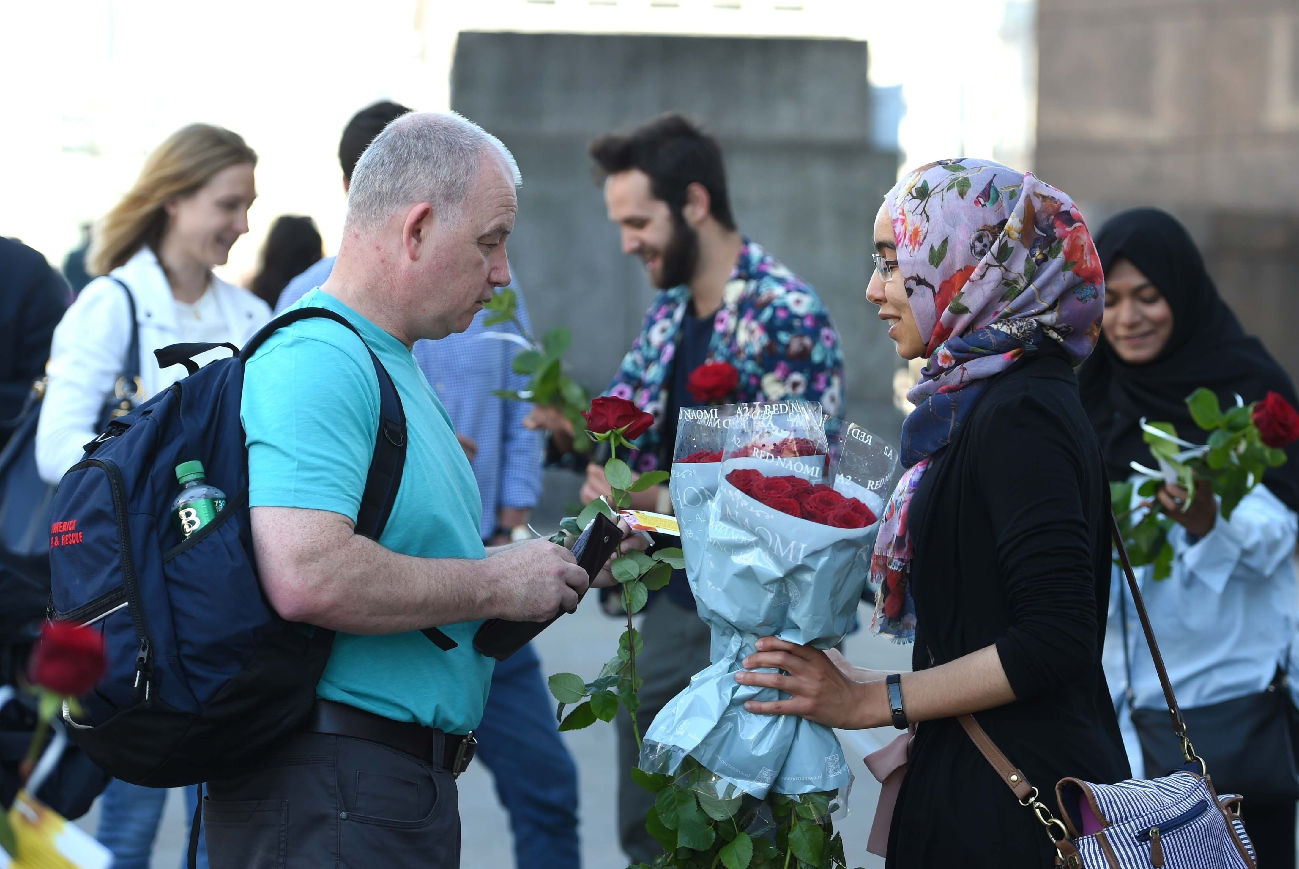 Muslims Hand Out Roses On London Bridge In Gesture Of 'Love And