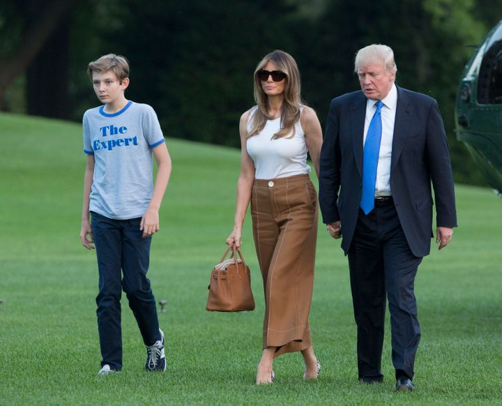 President Donald Trump, first lady Melania Trump and their son Barron Trump are seen arriving at the White House on Sunday.