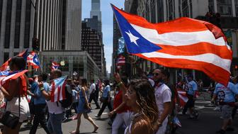 NEW YORK, NY - JUNE 11: People participate in the annual Puerto Rican Day Parade marching up 5th Ave. on June 11, 2017 in New York City. Tensions were heightened at this year's parade due to the participation of Oscar Lopez Rivera, a former Armed Forces of National Liberation member who served 35 years in prison for seditious conspiracy. The FALN, a Puerto Rican nationalist group, was responsible for a string of bombings in the 1970s and 1980s. (Photo by Stephanie Keith/Getty Images)