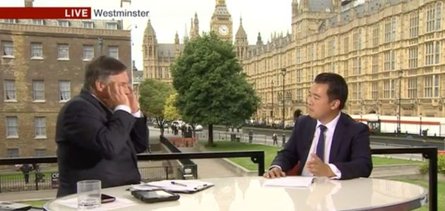 BBC presenterSimon McCoy holds his hands to his head after Tory MP Alan Mak claims the party is...