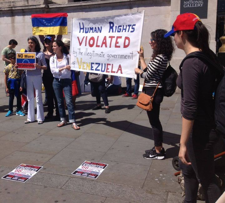 Demonstrators protest against human rights violations in Venezuela outside the National Gallery in London on 10 June.