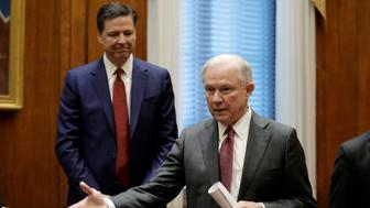 FILE PHOTO - U.S. Attorney General Jeff Sessions (R) gestures as FBI Director James Comey looks on before his first meeting with heads of federal law enforcement components at the Justice Department in Washington, U.S. on February 9, 2017.   REUTERS/Yuri Gripas/File Photo