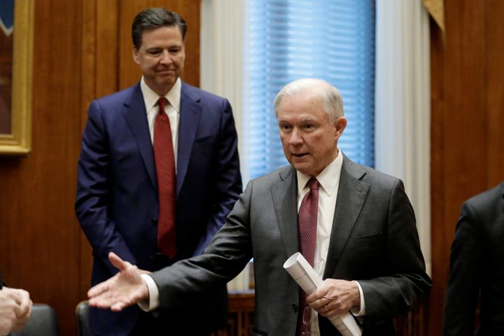 Attorney General Jeff Sessions gestures as then-FBI Director James Comey looks on at the Justice Department on Feb. 9, 2017.