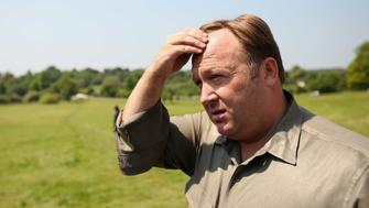 WATFORD, ENGLAND - JUNE 06:  Alex Jones, an American radio host, author and conspiracy theorist, addresses media and protesters in the protester encampment outside The Grove hotel, which is hosting the annual Bilderberg conference, on June 6, 2013 in Watford, England. The traditionally secretive conference, which has taken place since 1954, is expected to be attended by politicians, bank bosses, billionaires, chief executives and European royalty.  (Photo by Oli Scarff/Getty Images)
