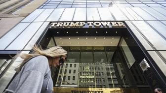 Pedestrians walk past Trump Tower in New York, U.S., on Thursday, May 4, 2017. President Donald Trump returns Thursday with all the fanfare of the presidency to the city that made him rich and famous yet has shunned him as a political leader. Photograph: Jeenah Moon/Bloomberg via Getty Images