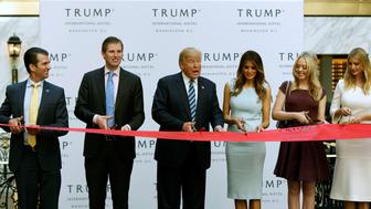 (L-R) Donald Trump Jr., Eric Trump, Republican U.S. presidential nominee Donald Trump, Melania Trump, Tiffany Trump and Ivanka Trump attend an official ribbon cutting ceremony at the new Trump International Hotel in Washington U.S., October 26, 2016. REUTERS/Gary Cameron