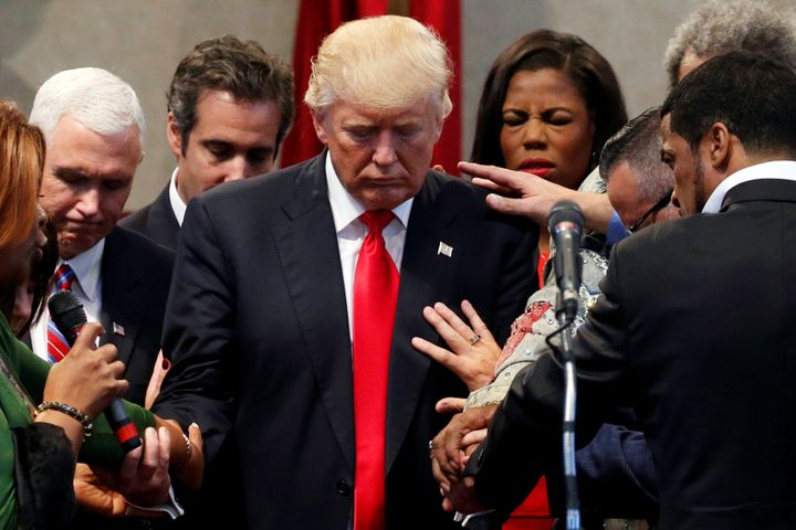 Members of the clergy pray over Donald Trump, then the Republican presidential nominee, on Sept. 21, 2016, at the New Spirit