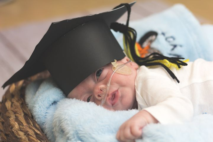 "On a baby's ""graduation day,"" he or she receives a homemade grad cap, a little goodbye ceremony and a complimentary photo shoot."
