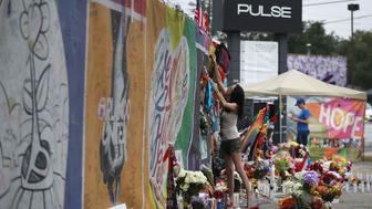 ORLANDO, FL - JUNE 12:  Claudette Mcintosh visits the memorial setup outside the Pulse gay nightclub as she remembers the victims of a mass shooting at the club one year ago on June 12, 2017 in Orlando, Florida. Omar Mateen killed 49 people at the club a little after 2 a.m. on June 12, 2016.  (Photo by Joe Raedle/Getty Images)