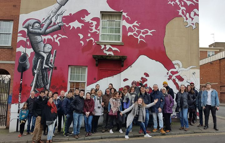 John Nation now guides visitors around Bristol's street art scene via WhereTheWall. Pictured here is one his recent tour grou