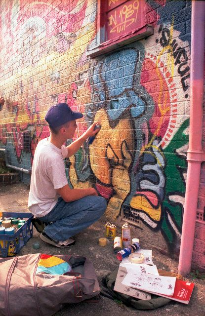 Street artist Cheo is pictured here painting at the Barton Hill Youth Centre in Bristol in 1989.