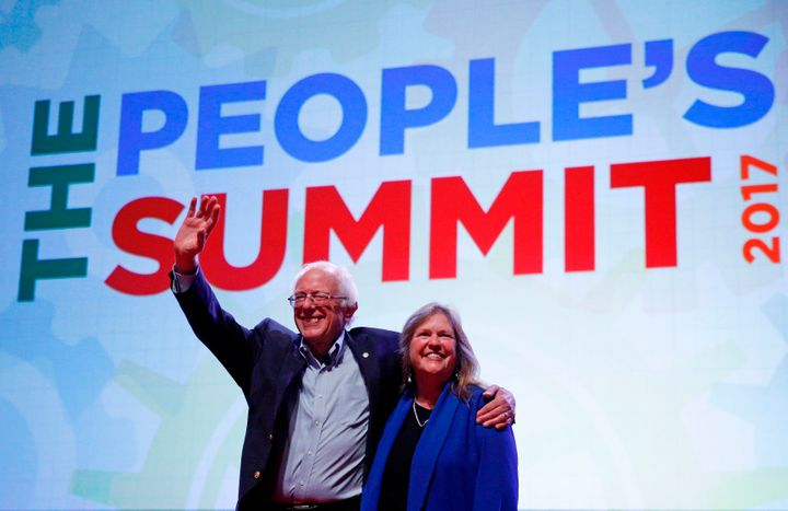 Sen. Bernie Sanders (I-Vt.) waves to the crowd alongside his wife Jane after his speech at The People's Summit in Chicago on