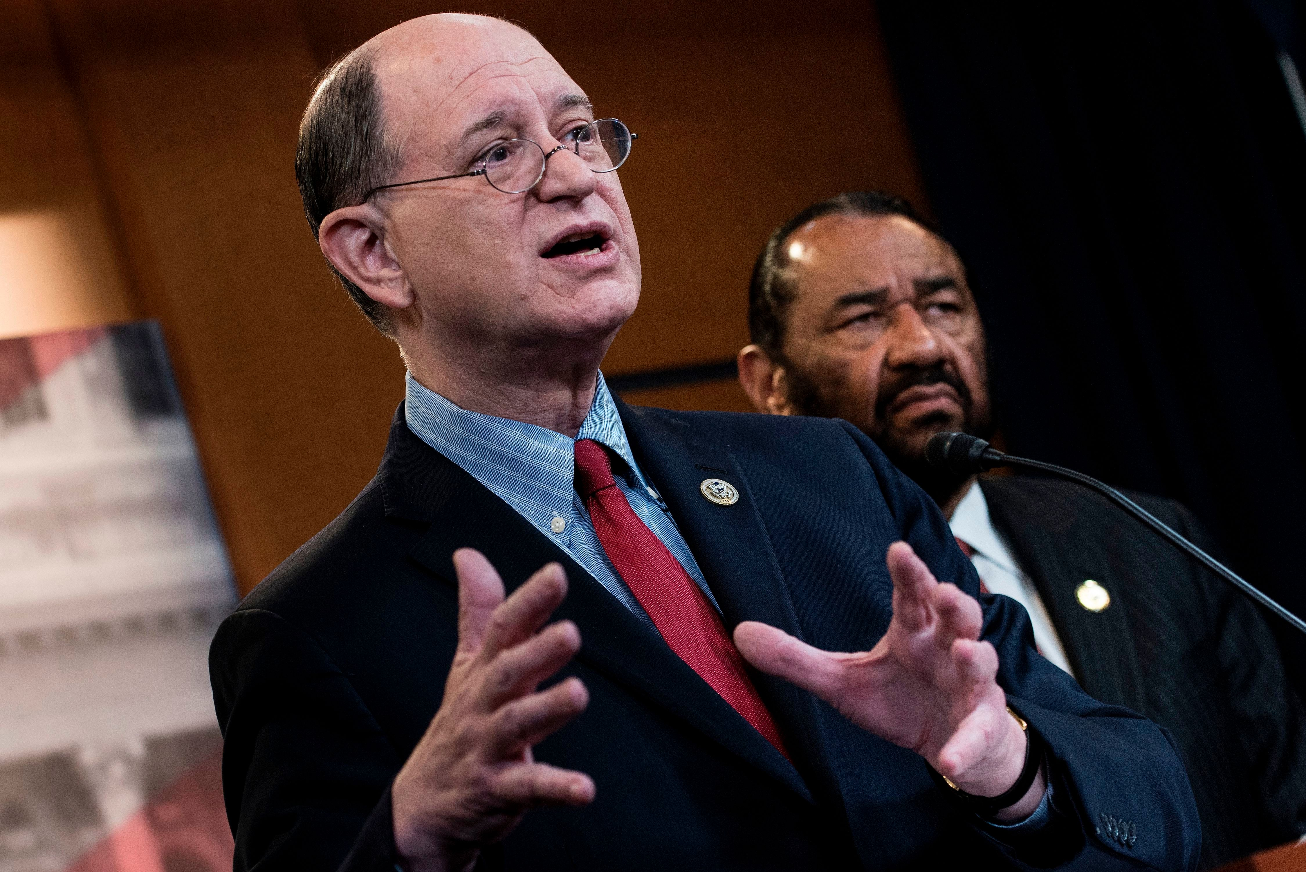US Representative Brad Sherman (L), Democrat of California,  and US Representative Al Green, Democrat of Texas, take questions about articles of impeachment for US President Donald Trump during a press conference on Capitol Hill June 7, 2017 in Washington, DC. Green submitted articles of impeachment against Trump Wednesday in the first legislative step for any congressional bid to remove the president from office. / AFP PHOTO / Brendan Smialowski        (Photo credit should read BRENDAN SMIALOWSKI/AFP/Getty Images)