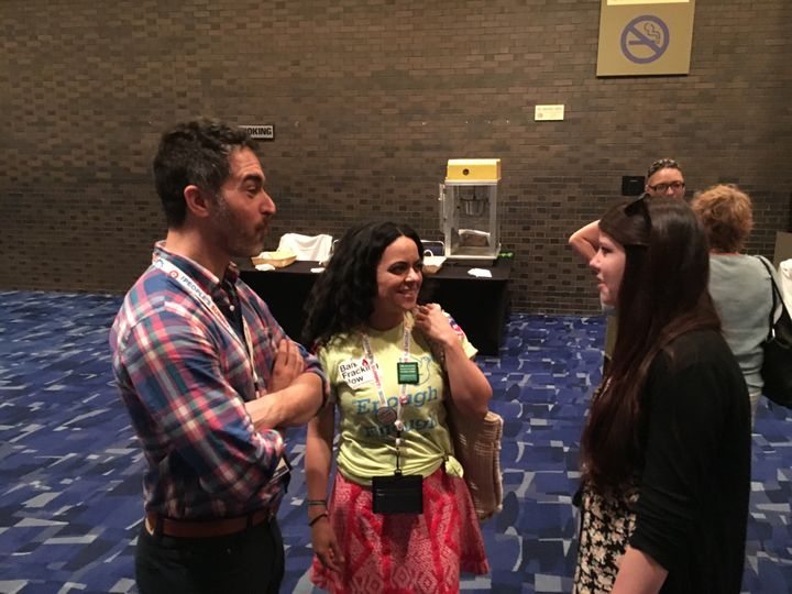 Dan Gordon, left, talks with with fellow California activists Marcia Martin, center, and Melissa Demyan after Bernie San